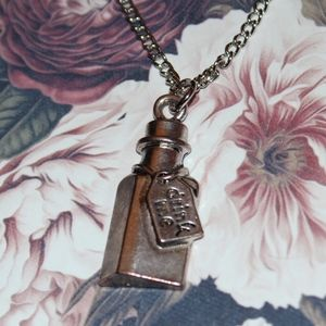New Alice In Wonderland Drink Me Necklace BOUTIQUE
